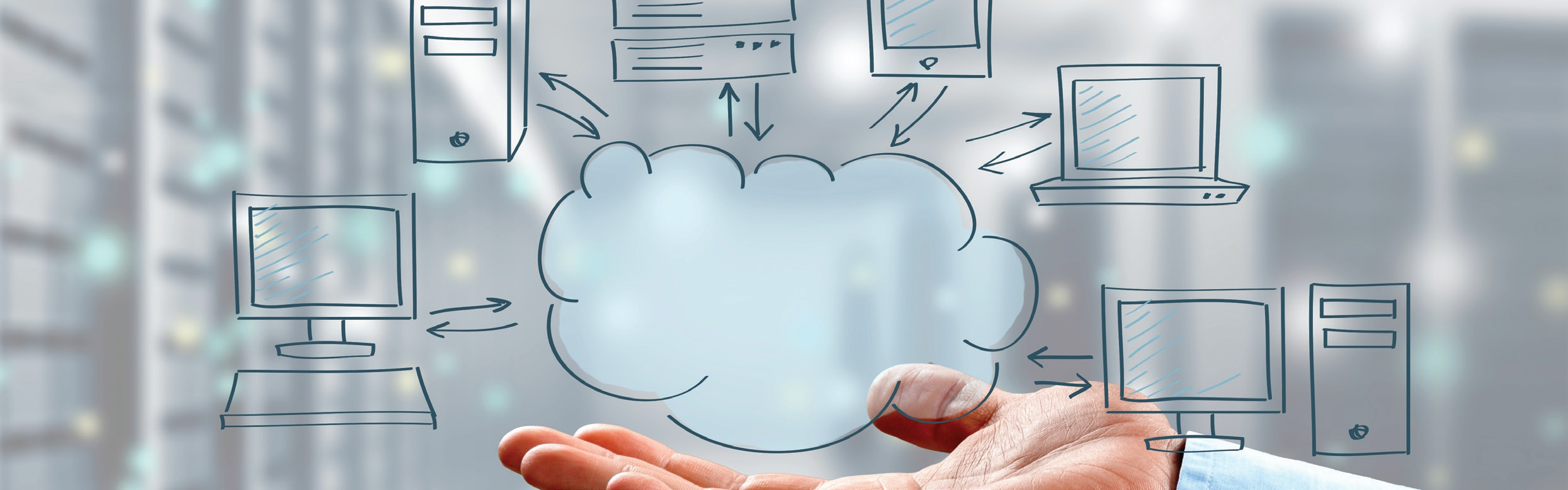 Image of a hand holding a cloud with a computer, filer and tablets floating over it